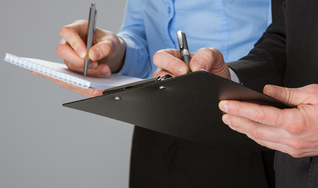 Closeup of working business team taking notes, concept of successful team work