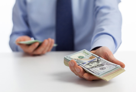 Need money? Businessman offering money to you photo