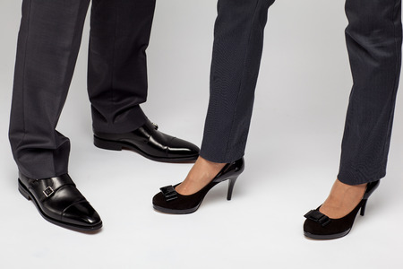 businesspersons: Male and female businesspersons legs Stock Photo