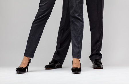 businesspersons: Male and female businesspersons legs - closeup shot