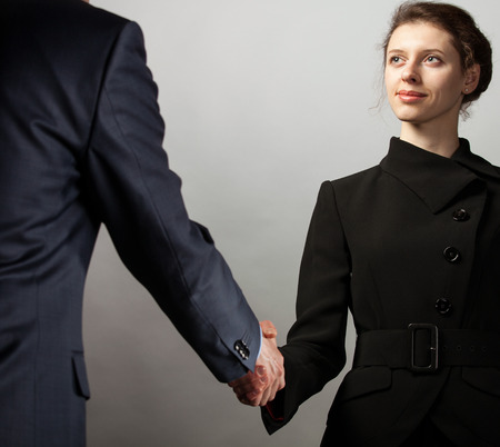 Handshake of business partners - man and woman photo