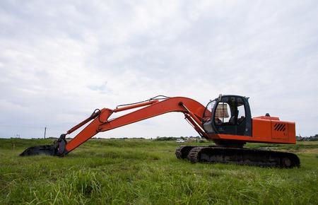 power shovel: Excavator on a summer  field