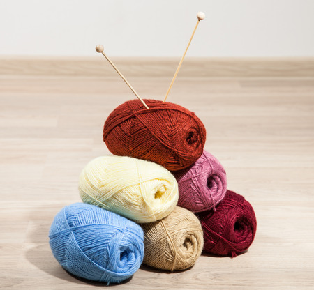 acrylic yarn: Skeins of yarn with knitting needle on wooden background