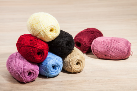 acrylic yarn: Skeins of yarn on wooden background
