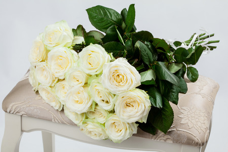 roseleaf: Bouquet of beautiful tea-roses on a banquette, neutral background Stock Photo