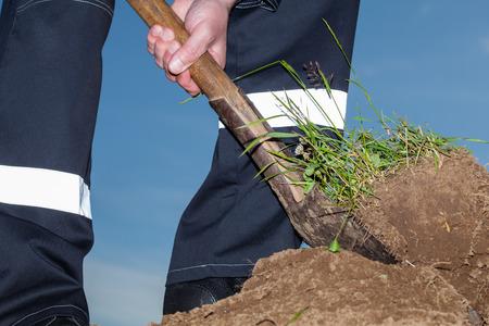 digging: Farmer digging a garden - closeup shot Stock Photo