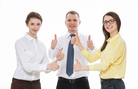 collaborator: Successful young business people showing thumbs up sign, white background