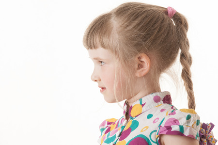 upgrowth: Portrait of a pretty little girl on white background, sideview Stock Photo