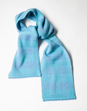Beautiful unisexual woolen scarf on white background Stock Photo