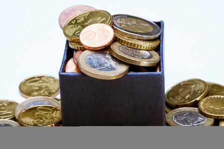 monetary devaluation: Euro coins in the blue box, macor shot