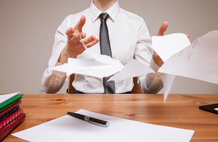 disrupt: Unrecognizable business woman throwing disrupt documents, closeup shot