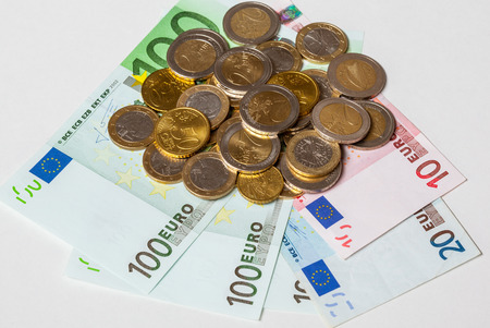 haggling: Euro banknotes and coins on neutral background Stock Photo