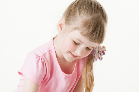 upgrowth: Portrait of a pretty little girl on white background Stock Photo