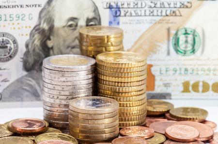 devaluation: Euro coins on dollars  background - closeup shot