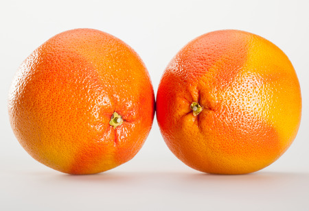 grapefruits: Ripe grapefruits on neutral background
