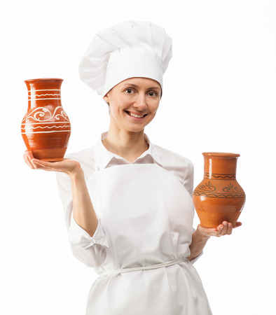 jugs: Attractive young woman holding clay jugs on white background Stock Photo