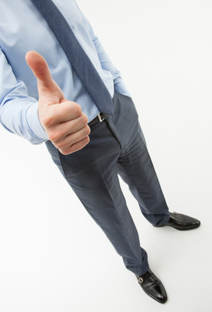 assent: Unrecognizable businessman showing thumb up, white background