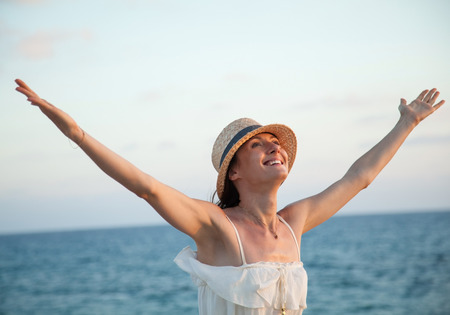 rejoices: Happy young woman  rejoices at summer vacation