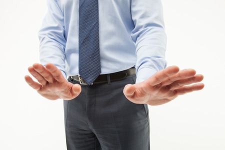 demonstrating: Unrecognizable businessman  demonstrating a gesture of a rejection, white background