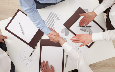 assent: Businessmen shake hands, view from above Stock Photo