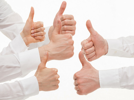 backing up: Many business people showing  thumb up signs on white background Stock Photo