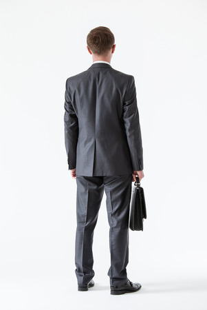 assured: Unrecognizable assured young businessman, rear view