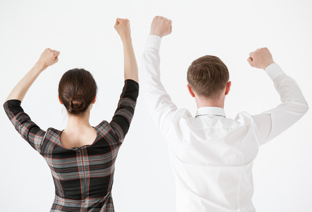 uphold: Business people showing fists raised up, white background