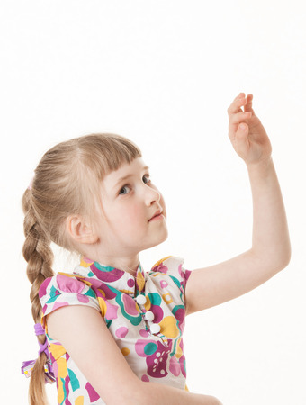 upgrowth: Pretty little girl showing an indefinite gesture, white background