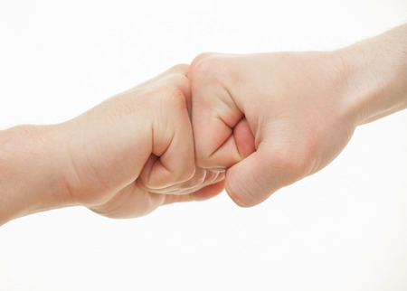 strife: Two male hands demonstrating a gesture of a strife, white background