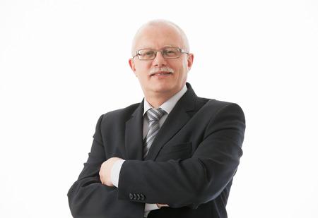mature business man: Portrait of a friendly mature basinessman on white background Stock Photo