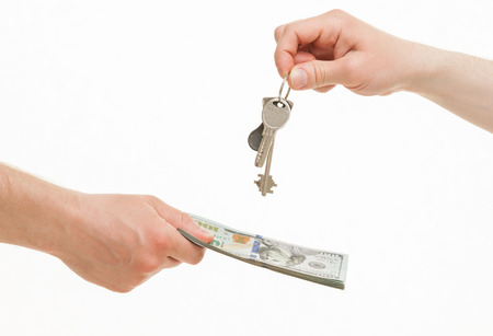 Business people exchanging keys and money, white background