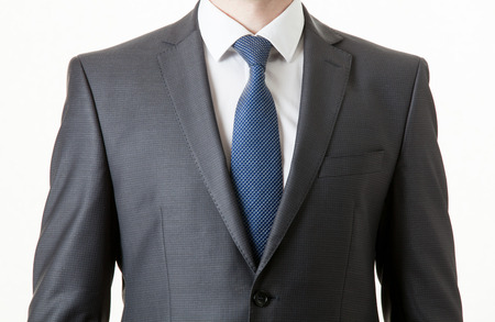 tie: Unrecognizable businessman in a classical suit, white background