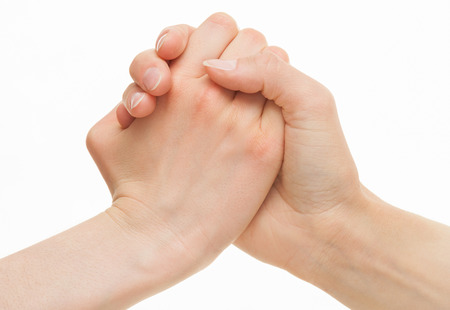 strife: Human hands demonstrating a gesture of a strife or solidarity, white background Stock Photo