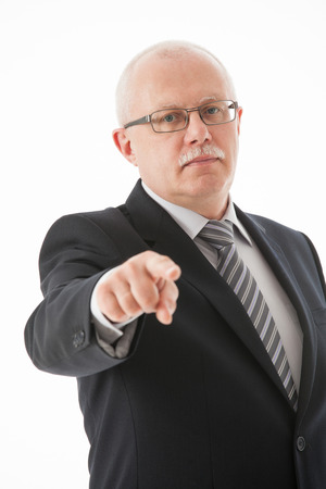 directive: Strict mature businessman indicating you, white background Stock Photo
