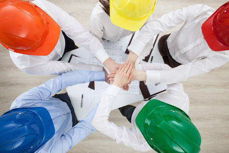 construction project: Group discussion in a construction company, view from above