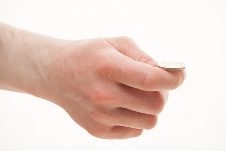 tell fortunes: Male hand holding a coin, white background