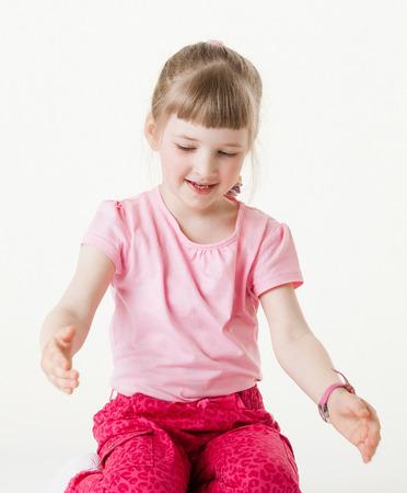 large size: Smiling little girl showing something large size, white background