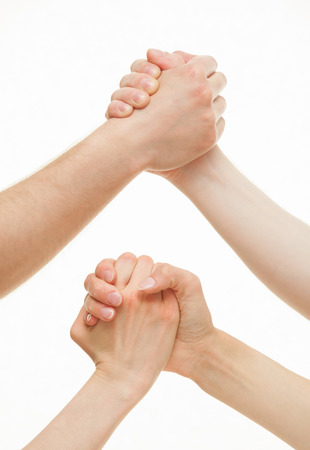 female wrestling: Human hands demonstrating a gesture of a strife or solidarity, white background Stock Photo
