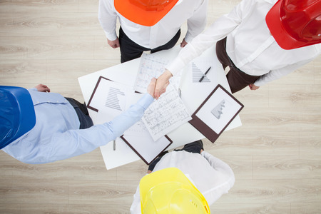 assent: Group discussion in a construction company, view from above