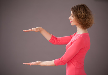 mid distance: Yong woman showing a middle distance between her hand