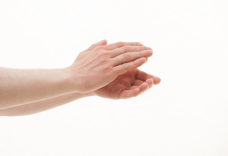 clapping hands: Male hands applauding, white background