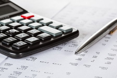 financial risk: Currency cross-rate table, calculator and a pen; concept of financial analysis Stock Photo