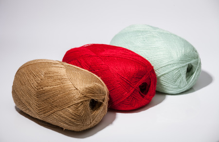 acrylic yarn: Three skeins of yarn on neutral background