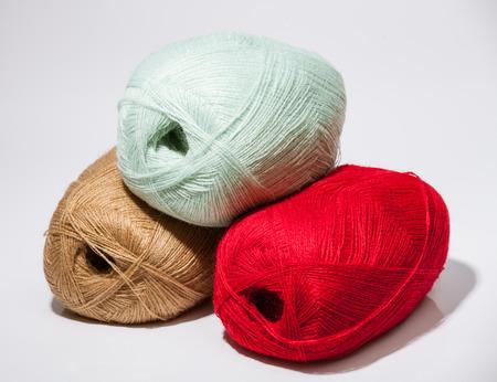 neutral background: Three skeins of yarn on neutral background