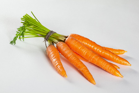neutral background: Bunch of fresh carrot on neutral background Stock Photo