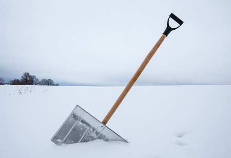 Removing snow with a shovel Stock Photo