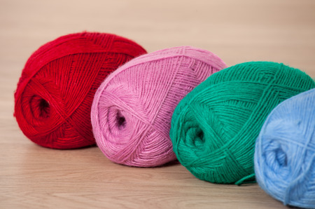 acrylic yarn: Three skeins of yarn on wooden background