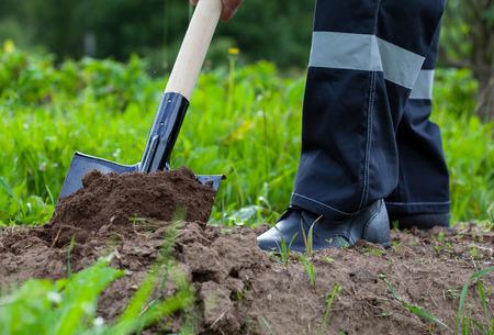 Farmer digging a garden - closeup shot Stock Photo