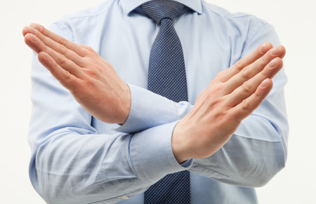 cross ties: Unrecognizable businessman  demonstrating a gesture of a rejection, white background