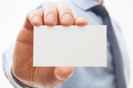 Unrecognizable businessman showing business card - closeup shot Imagens